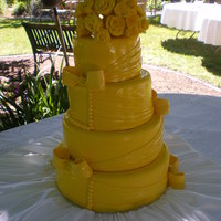 Yellow Wedding Cake 12, 10, 8, and 6 inch cakes, fondant roses. Found a picture of a cake by cakes by May and loved it do much I had to try it.
