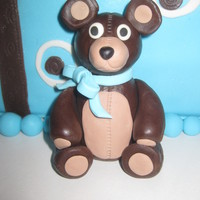 "Baby Boy Shower 10"" square, fondant covered with Choco-pan bear and 50/50 mix bow. Gumpaste baby shoes."