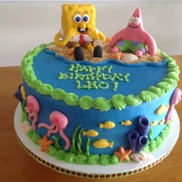 Spongebob Cake BC covered cake with fondant figurines. Spongebob was started with RKT before covering. Fish and seashells were white chocolate.