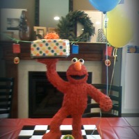 Elmo Is Ready To Party  Second birthday cake for twins who love Elmo. Elmo is 25 inches high, sculpted from RKT and covered with royal icing. He is standing on one...