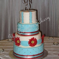 Strawberry Red & Aqua Wedding 6-8-10-12 round tiers iced in buttercream. Fondant details and silk flowers. Two tiers were chocolate chip cake with raspberry filling; two...