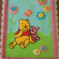 Winnie The Pooh Winnie the Pooh baby shower cake made with BC and MMF decorations.