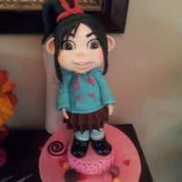 "Vanellope Figure This is a entry for a local cake show. She did not make it. She is 12"" high and I had trouble with the support she was leaning to one..."