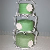 Sage Green Wedding Cake This was a gift to a couple who got married at our church. Flowers made from gumpaste.