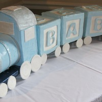 Baby Blocks Train Cake  The request was for a set of baby blocks with impact. I thought it would be fun to have them being pulled by a train. There was a moment...