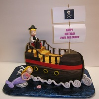 Mermaid And Pirate And Ship  Sooo much inspiration found from Debbie Brown and Cake Central. I loved the reaction of the receiver when I delivered this cake. The cake...