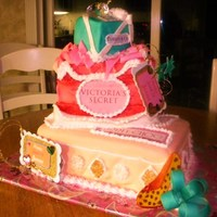 Sweet 16 shoe box, victoria secret bag, tiffany box all made out of cake covered with fondnt and hand detailed with food color paint and fondant.