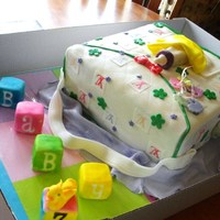 Welcome Baby Z   LV diaper bag with blocks. Marble, choc, white covered in fondant, blocks are pound cake covered in fondant and airbrushed