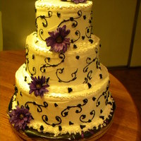 Wedding Shower Cake white/raspberry; choc ganach iced with better cream, piped in black icing, live purple mums for decor