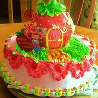 Maddie's Cake   2 tier strawberry cake filled with macerated strawberries and whipped cream iced with bettercream.