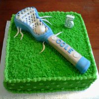 Lacrosse Cake Chocolate fudge cake with vanilla buttercream filling.