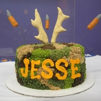 Bullets And Antlers   Cake iced in buttercream with fondant bullets and antlers
