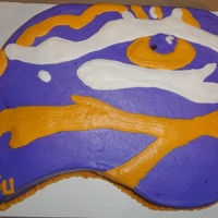 Tiger's Eye Sheet cake carved and iced with buttercream to resemble the LSU Tiger eye in the middle of the field.