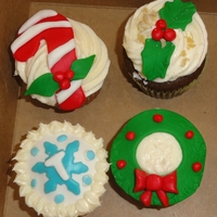 Christmas Cupcakes Cupcakes iced in buttercream with fondant accents