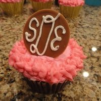 Monogram Express Cupcake iced with buttercream and a fondant circle with buttercream monogram
