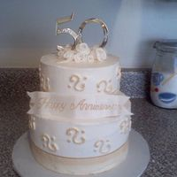 50Th Wedding Anniversary Iced in Lemon Buttercream, Butter cake w/ Lemon Raspberry filling.