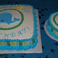 Whale And Seahorse First Birthday   White cake with french vanilla buttercream icing. Decorated in buttecream with gumpaste whale and seahorse (cut with cricut cake).
