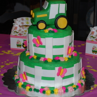 Girl's Tractor Cake   tractor themed cake for 2 yr old bday party - chocolate cake with buttercream icing - tractor, fence, and butterflies made of fondant