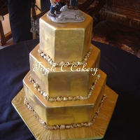 Ayesha & Shawn 3-tiered hexagon cake for a pair of geologists who work in the gold fields in Australia. Painted with edible gold, gold leaf and gold...