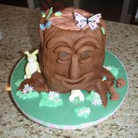 Tree Stump Cake Made this for my daughter's brownie/daisy bridging ceremony. Strawberry lemonade cake with strawberry buttercream. Covered in fondant...