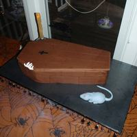 Halloween Coffin With Skeleton White Chocolate cake with fudge/caramel/pecan filling - delicious! All fondant covered, fondant rat, gumpaste skeleton hand. Candlestick...