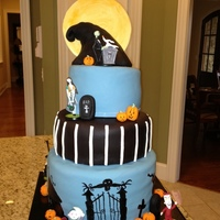 Nightmare Before Christmas Nightmare before Christmas cake. Fondant covered, Rice Krispie mountain, fondant decorations, I bought the figurines because I was short on...