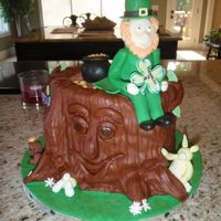 Irish Themed Birthday Cake Based on Debbie Brown's design. WASC cake with cookie dough filling. Leprechaun face is made from modelling chocolate (my new favorite...