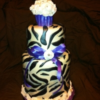 Zebra Sweet 16 Third zebra cake this month..............this one is 2- 8inch tiers, a 6 inch tier and a standard cupcake. Real ribbon at request of client...