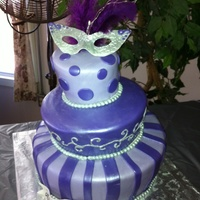 Purple Quince Topsy Turvy A very fun quince TT cake! 14 in, 10 in, and 6 in cakes covered in MMF with MMF accents. Piping on middle tier in RI brushed with liquid...
