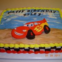 Cars This was for a 4 yrs. old. He loves lightning mcqueen. I cut the car from fondant, after making a pattern with mylar and airbrush....