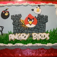 Angry Birds Buttercream with fondant accents. Chocolate cake with chocolate chip filling.