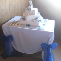 Wedding Cake  The client wanted a White cake with Blue Calla Lilly's. I wasn't sure about that, but I think it turned out just fine. It fit the...