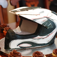 Motocross Helmet  Motocross helmet made entirely out of cake. The visor is fondant that I molded to an actual helmet visor. Covered in fondant and hand...
