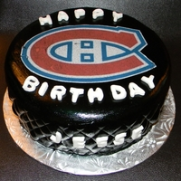 Canadiens Hockey Puck  Chocolate cake with french vanilla frosting. The Canadiens logo is an edible image. The black was painted on to the fondant. Thank you to...