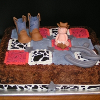 Cowboy Baby Quilt All buttercream, with fondant quilt, and gumpaste baby and boots.