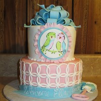 "Love Birds Baby shower cake inspired by her bedding called ""love birds"". Cake is covered in MFF, and the birds are hand-painted. Loop bow..."
