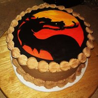 Mortal Kombat Cake A cake I did for my boyfriend's birthday. The cake is butter yellow with nutella filling and choc buttercream icing. The logo is made...