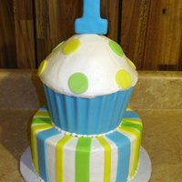 "1St Birthday Cupcake Cake This is the cake I made for my cousin's first birthday. The cupcake ""wrapper"" is done with blue candy melts, and I used the..."