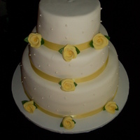 Summer Wedding Cake simple yellow fondant roses bottom tier yellow cake with choc. pudding middle tier yellow cake with vanilla pudding top tier yellow cake...