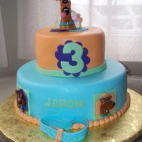 Scooby Doo All buttercreme with some fondant trim, Scooby on the top is candle. the scooby faces are cake rings.