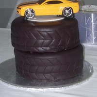 Car Tires/ Was A Grooms Cake Tires are Cake covered in fondant. Car is a model that belong to the groom.