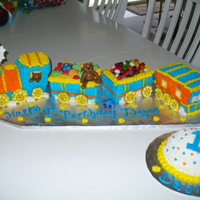 Choo Choo Train First Birthday Cake wilton 3-d train pan engine, then 6 x 4 inch cars and caboose, all buttercream, nilla wafer wheels with bc accents, fondant toys and jelly...