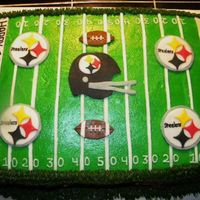 Pittsburgh Steelers Football Cake 1/2 sheet frosted with buttercream. Images are made from modeling chocolate.