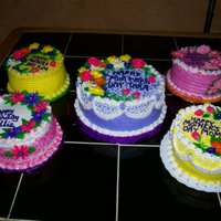 Collection Of Floral Mother's Day Cakes Four of these cakes a 6-inch rounds. The middle one is an 8 inch round. All frosted with buttercream with mainly buttercream flowers. Have...