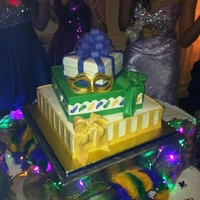 Sweet Sixteen Mardi Gras Theme Cake Buttercream icing with fondant bow and decorations. Mask was made out of gumpaste.