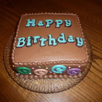 Birthday Chocolate buttercream with molded chocolate letters and swirls
