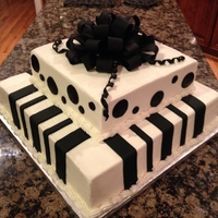 Black And White 2 tiered cake buttervream with fondant accents