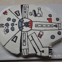 Star Wars Millenium Falcon Cake Sheet cake cut out in the basic shape of the Millenium Falcon from Star Wars.