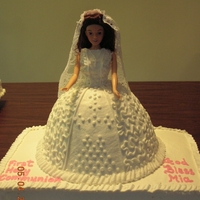 Doll First Communion Cake   Doll cake on top of a 9x13 cake.