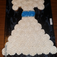 Wedding Dress Cupcake Cake. This cupcake cake is made with 51 cupcakes.